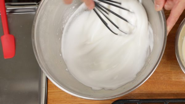 Just before the meringue is ready, switch to a balloon whisk and check its consistency. Beat until the meringue reaches a firm peak stage and has a glossy texture.
