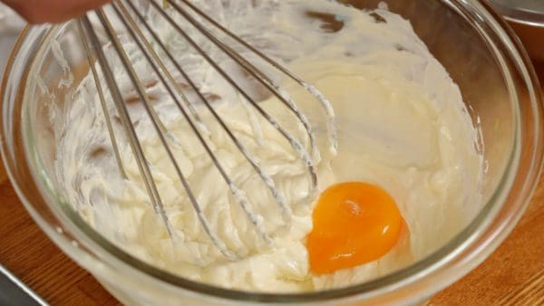 Add one egg yolk and mix thoroughly.