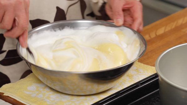 And quickly fold in the batter again but avoid breaking the foam to create a light and fluffy cake.