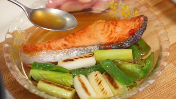 Place the salmon onto the plate. Spoon the marinade over the ingredients and let them sit until cool.