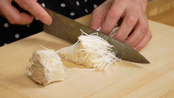 Remove the stem ends of the enoki mushrooms. Cut the enoki in half. Shiitake or maitake mushrooms can be also used for this recipe.