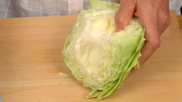 Meanwhile, remove the core of the cabbage. Take out the center part and then shred the leaves.