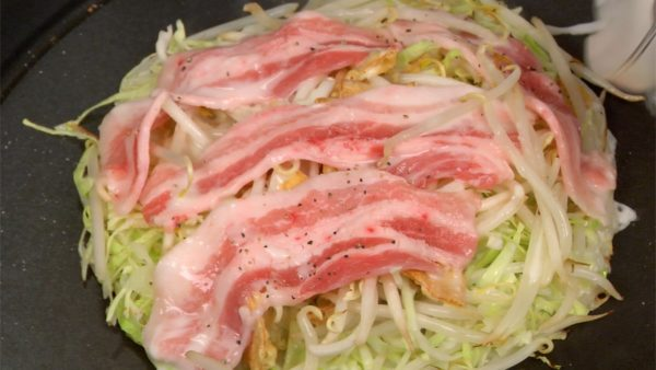 Season the pork slices with the salt and the pepper. Stir the remaining batter and pour it onto the okonomiyaki. This will help to combine the vegetables and also prevent the pork from getting tough.