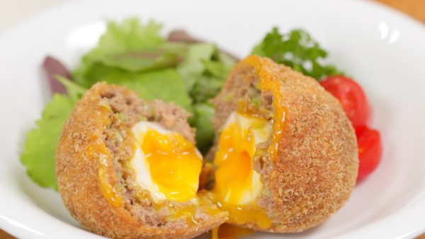 Place the scotch egg onto a plate along with the salad. Enjoy the dish with mustard or you can add your favorite sauce to taste.