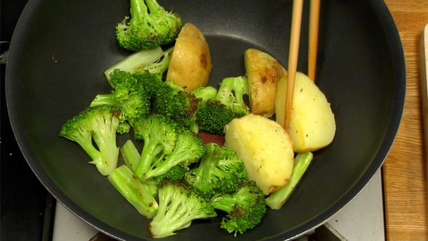 Remove the lid, and stir the vegetables. Toss the pan to cook evenly and place the vegetables on a plate. Serve the tomato, broccoli and potato on a plate.