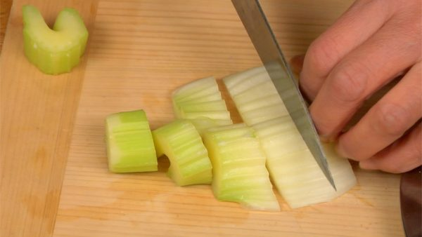Remove the firm stringy parts of the celery. And then cut into bite-size pieces.