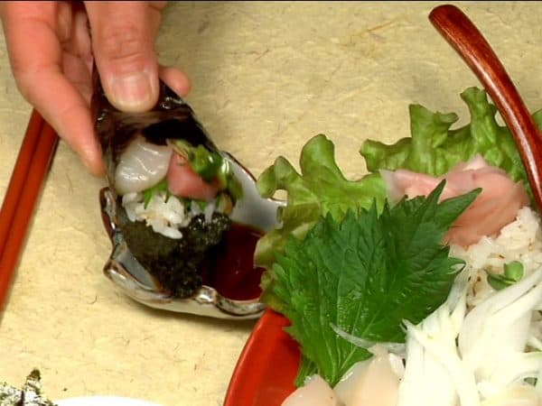 Dip the top of Temaki Sushi in soy sauce and enjoy it!