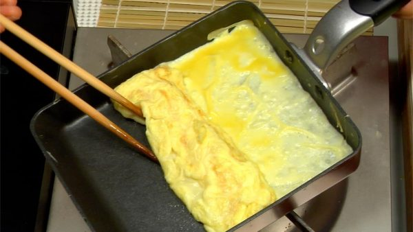 When the egg is almost cooked, roll the omelet toward yourself.