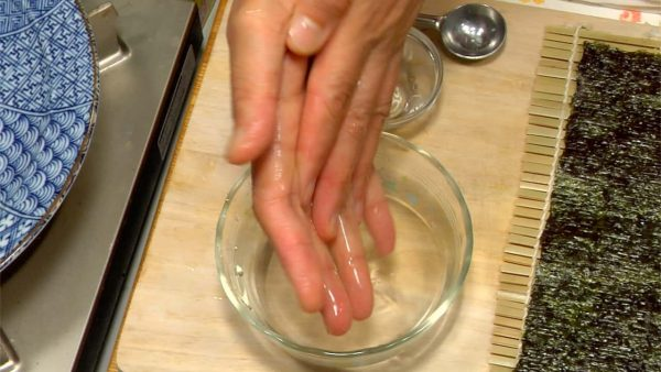 Wetting your hands with vinegar water will keep them away from germs and prevents the rice from sticking.