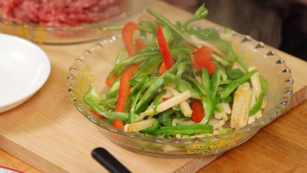 Continue to stir-fry until the bell pepper is 3 quarters cooked. Then, place the vegetables onto a plate.