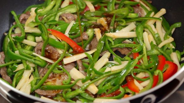 Then, gradually pour in the sauce and continue stir-frying it on high heat.
