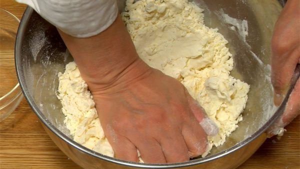 Press the crumbly flour mixture with your hand and form into a dough ball.