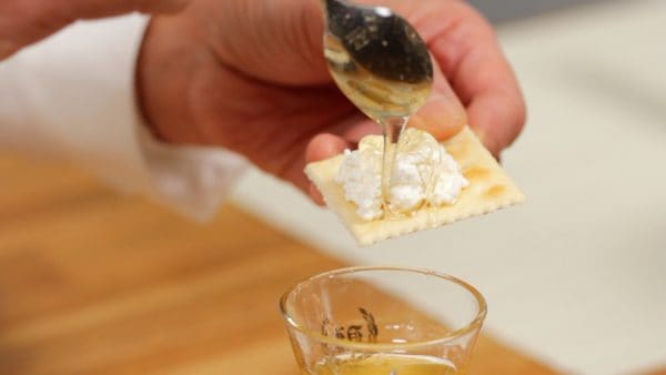 Enjoy the cheese with crackers. Sprinkle on the salt and drizzle on the honey to taste.