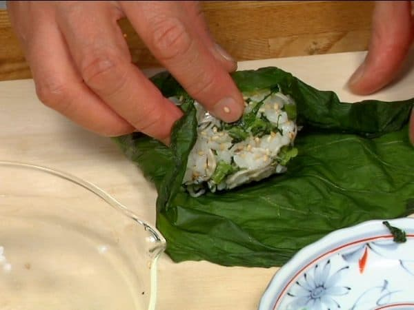 Wrap the onigiri with the pickled hiroshimana leaf.