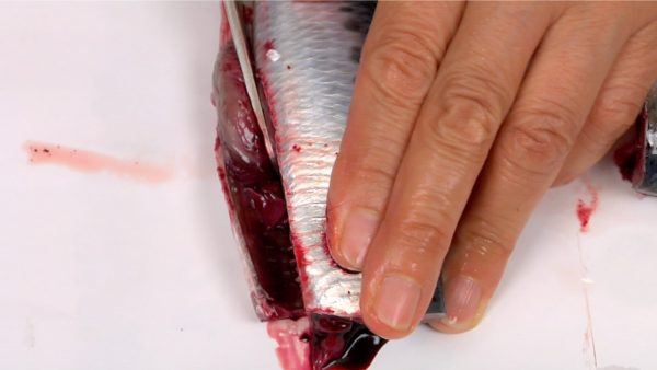 Slice off the belly lengthwise, removing the hard rib bones.