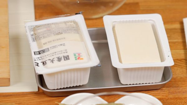 Next, freeze the packaged firm tofu and then thaw it at room temperature. This will give the tofu a spongy and chewy texture, which helps to imitate a meat-like texture.