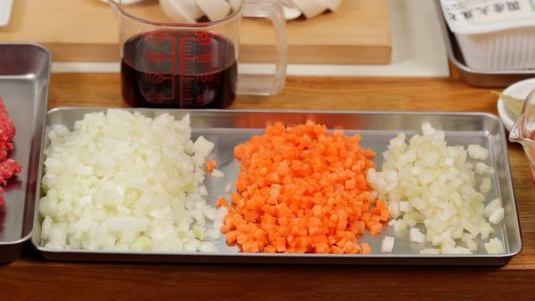 """As for the vegetables, cut the onion, carrot and celery into 5mm (0.2"""") pieces. And chop the garlic clove into fine pieces."""