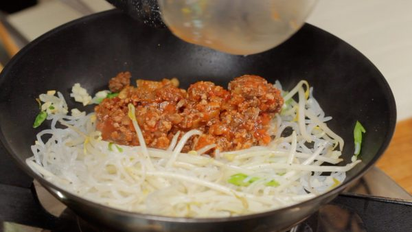 Gather the noodles to one side and warm up the meat sauce.