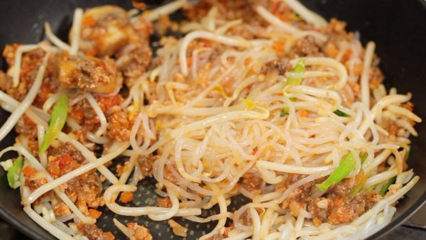 Toss the noodles to coat with the sauce.