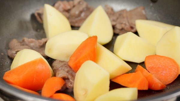 Now, add the potato and carrot and stir-fry.