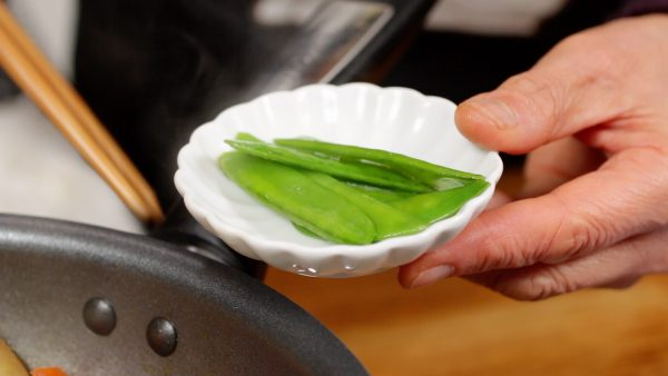 Remove the snow peas to keep them from discoloring.