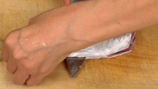 And slide the blade along the backbone toward the head, removing the fillet.