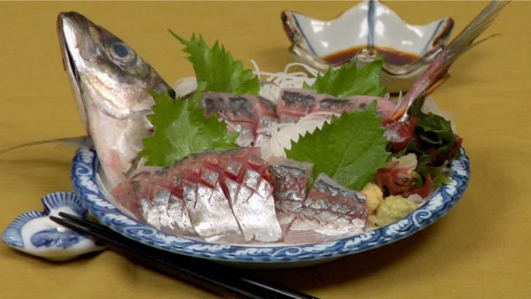 Rinse the head and tail thoroughly and place them next to the sashimi as a dramatic garnish emphasizing the freshness of the dish.