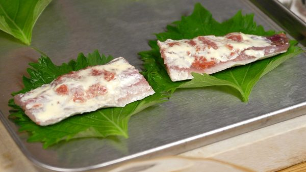 Now, place each fillet onto a shiso leaf in a tray.