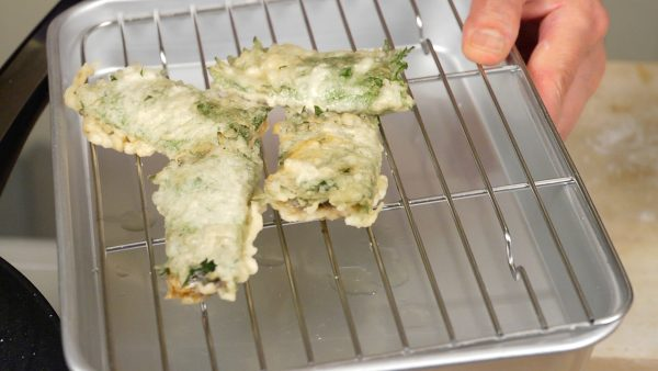 Remove the Shiso Wrapped Sardines and place them onto a cooling rack.