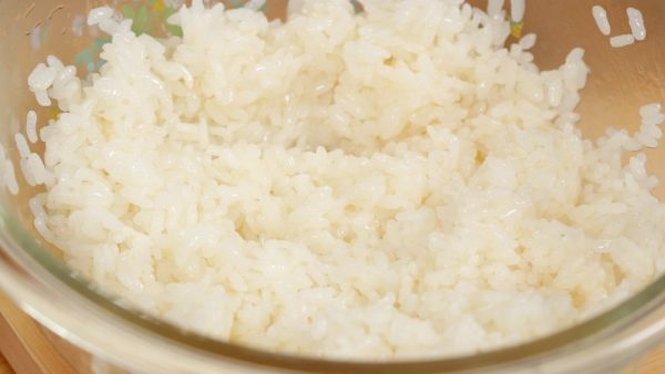 Use a fan to slightly cool the rice. This will help give it a glossy texture and remove the excess moisture.