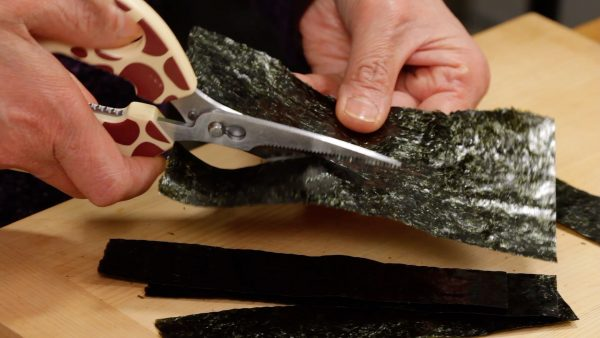 Then, cut the rest of the nori into strips along the lines.