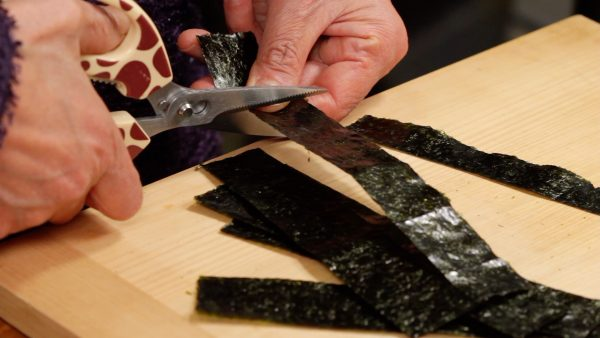 Finally, trim off the first longer strip and you have 6 strips of nori.