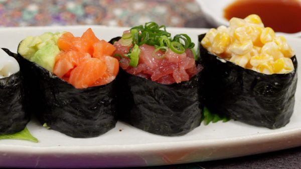 Enjoy the gunkanmaki before the nori gets soggy and the toppings fall off.