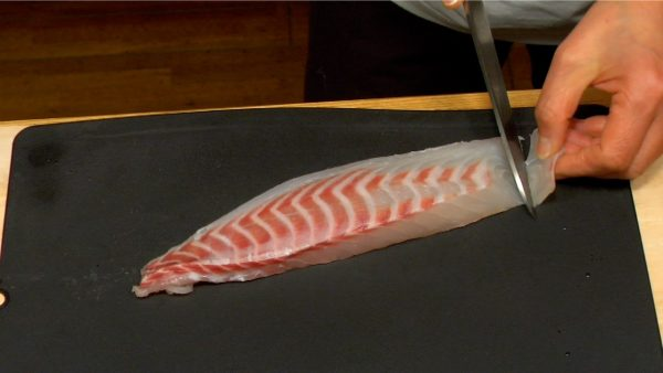 """Slice the tai also known as red sea bream into 5 to 6 mm (0.2"""") slices."""