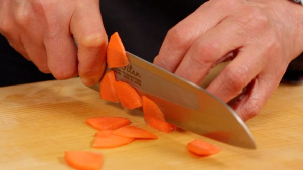 """Slice the carrot into 1 mm (0.05"""") quarter moons."""