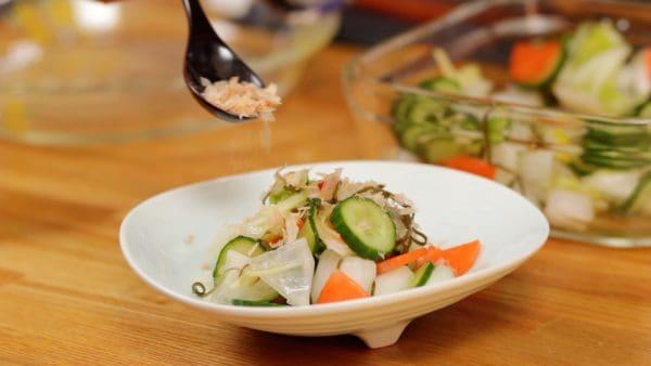Arrange the asazuke into a bowl. Top with the bonito flakes also known as katsuobushi.