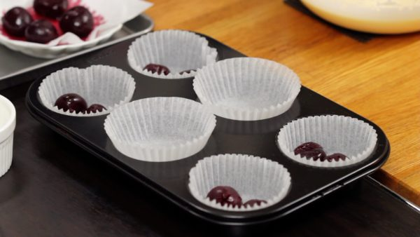 Arrange the silicone coated cupcake liners in a muffin pan.